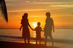 happy-family-two-kids-sunset-beach-tropical-56719950